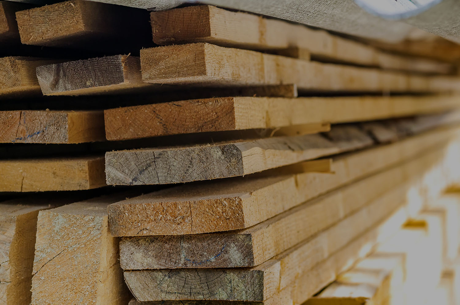 Stacked lumber, backdrop for Yellowstone Lumber page